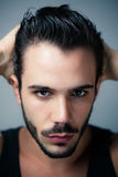 Handsome man styling hair Stock Photography