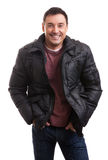 Handsome man in a stylish down jacket Stock Photos