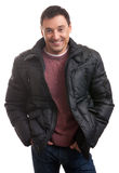 Handsome man in a stylish down jacket Royalty Free Stock Photos