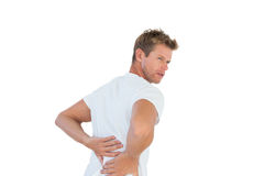 Handsome man suffering from back pain Royalty Free Stock Photography