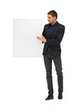Handsome man in suit with a blank board Royalty Free Stock Photos