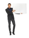 Handsome man in suit with a blank board Stock Image