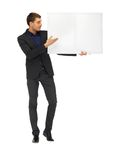 Handsome man in suit with a blank board Stock Images