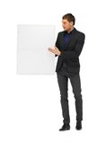 Handsome man in suit with a blank board Royalty Free Stock Images