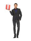 Handsome man in suit with a gift box Royalty Free Stock Photography