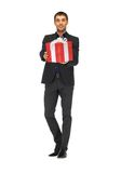 Handsome man in suit with a gift box Stock Image