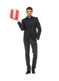 handsome man in suit with a gift box stock photos