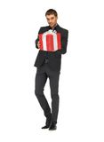 Handsome man in suit with a gift box Royalty Free Stock Photos