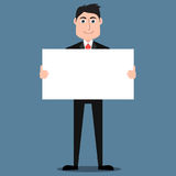 Handsome man in suit holding blank placard Stock Image