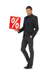 Handsome man in suit with percent sign Stock Photography