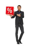 Handsome man in suit with percent sign Stock Image