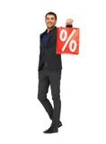 Handsome man in suit with percent sign Stock Photo