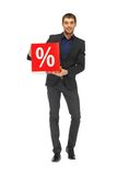 Handsome man in suit with percent sign Royalty Free Stock Image