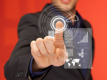 Handsome man in suit pressing virtual button Stock Image