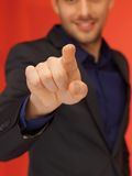 Handsome man in suit pressing virtual button Royalty Free Stock Photo