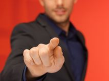 Handsome man in suit pressing virtual button. Bright picture of handsome man in suit pressing virtual button Stock Image