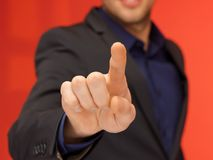 Handsome man in suit pressing virtual button Royalty Free Stock Images