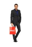 Handsome man in suit with shopping bags Royalty Free Stock Photos