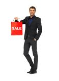 Handsome man in suit with shopping bags Royalty Free Stock Image