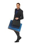 Handsome man in suit with shopping bags Stock Photo