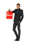 Handsome man in suit with shopping bags Stock Images