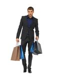 Handsome man in suit with shopping bags Royalty Free Stock Photo