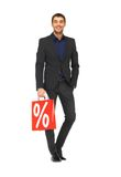 Handsome man in suit with shopping bags Royalty Free Stock Photography
