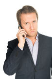 Handsome man in suit speaks on the mobile phone Stock Photo
