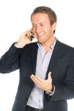 Handsome man in suit speaks on the mobile phone very happy Stock Photo