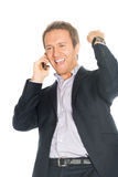 Handsome man in suit speaks on the mobile phone very happy Royalty Free Stock Image