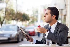 Handsome man with suit is using laptop in cafe Royalty Free Stock Photography