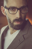 Handsome man in a suit weaing glasses Stock Images