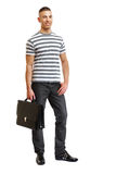Handsome man with suitcase in studio Stock Photos