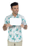 Handsome man with summer clothes, showing blank card. royalty free stock image