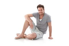 Handsome man in summer clothes smiling Stock Photos