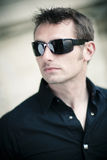 Handsome man with sunglasses Stock Photos
