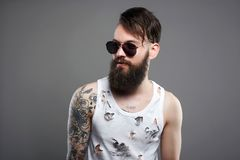 Handsome man in sunglasses. Brutal bearded hipster stock images