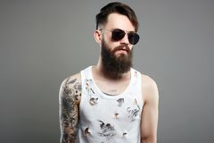 Handsome man in sunglasses. Brutal bearded hipster stock photography