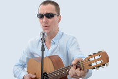 Handsome man with sunglasses singing Stock Photo