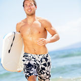 Handsome man surfer fun on summer beach Stock Photos