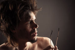 Handsome man surprised charred wires Stock Image