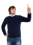 Handsome man in sweater pointing his finger up Royalty Free Stock Image