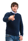 Handsome man in sweater pointing  his finger Stock Photo
