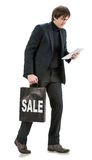 Handsome man with tablet pc and  shopping bag Royalty Free Stock Photo