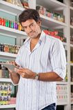 Handsome Man With Tablet In Supermarket Stock Photos