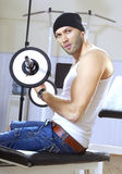 Handsome man takes exercises Stock Images