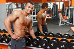 Handsome man taking barbell in gym Royalty Free Stock Photos
