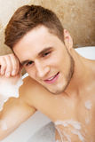 Handsome man taking a bath. Royalty Free Stock Photos