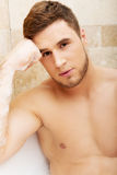 Handsome man taking a bath. Royalty Free Stock Photography