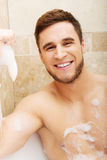 Handsome man taking a bath. Stock Photo